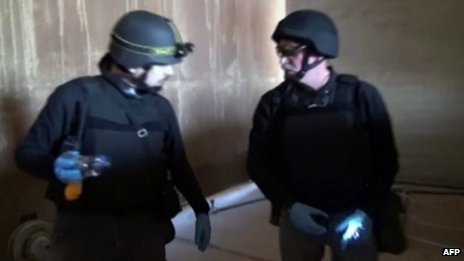 An image grab taken from Syrian television shows inspectors from the Organisation for the Prohibition of Chemical Weapons (OPCW) at work at an undisclosed location in Syria on 10 October 2013