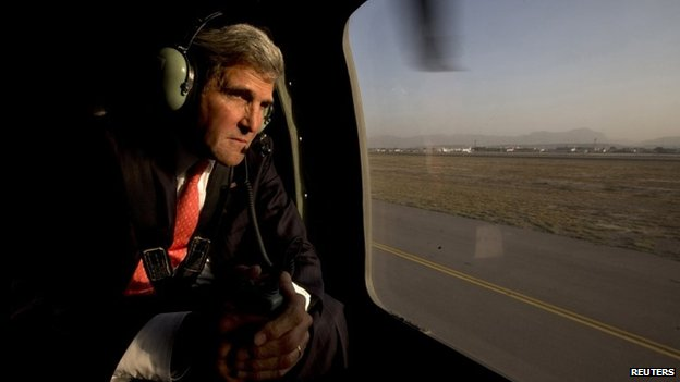 US Secretary of State John Kerry aboard a helicopter in Kabul, 11 October