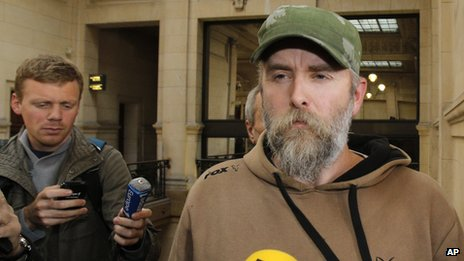 Norwegian Kristian Vikernes, 40, arrives at a Paris courthouse to answer charges of allegedly inciting racial hatred and other charges (17 October 2013)