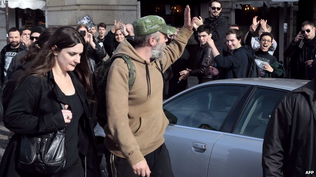Norwegian far-right activist Kristian Vikernes (C) waves to supporters after a court hearing (17 Oct 2013)