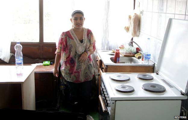 Leonarda Dibrani poses in her kitchen in Mitrovica, Kosovo, 17 October