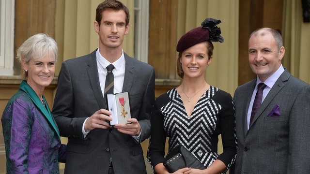 Andy Murray poses with his OBE medal alongside his family