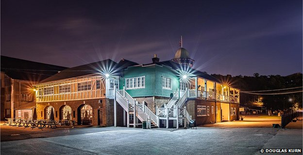 The Brooklands Clubhouse at night.