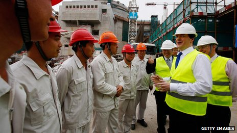 George Osborne talks with workers at Taishan power plant (17 Oct 2013)