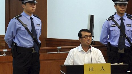 Wang Lijun, centre, at the trial of Bo Xilai, Shandong province, China 24 August 2013