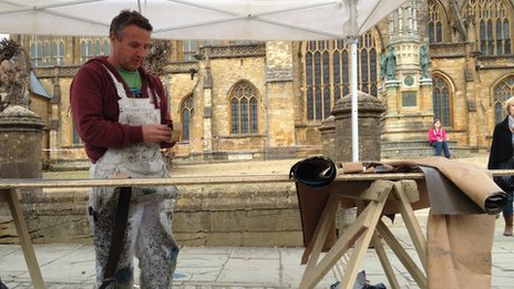 Set painter Andy Armstrong working outside Sherborne Abbey ahead of filming
