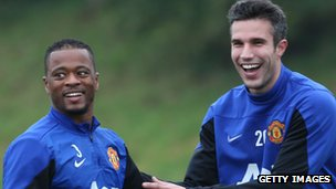 Manchester United's Robin Van Persie and Patrice Evra