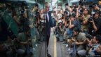 London Mayor Boris Johnson gets off a London bus during his visit in Hong Kong
