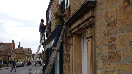Painters transforming shops in Sherborne ahead of the filming