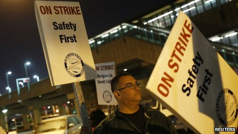 A station agent with Bay Area Rapid Transit was seen picketing outside an Oakland, California station on 18 October 2013