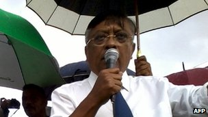 "Madagascan presidential candidate Jean Louis Robinson (R) delivers a speech at during a rally on October 13, 2013 in Antananarivo, ahead of Madagascar""s presidential election of October 25."