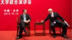 Britain's Chancellor of the Exchequer George Osborne (left) and London mayor Boris Johnson hold a question and answer session at Peking University in Beijing during a six-day visit to China