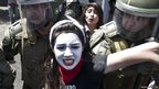 In Santiago a student is arrested during a protest for better public education in Chile