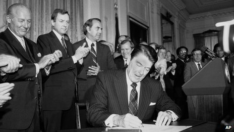 Ronald Reagan, pictured with congressional lawmakers on 30 June 1982
