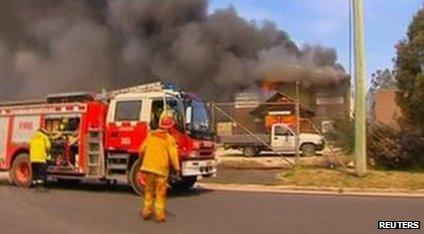 Firefighters from New South Wales Rural Fire Service (RFS) arrive to put out a fire at a property in Lithgow, New South Wales