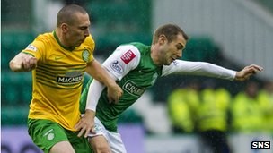 Scott Brown and Kevin Thomson contest possession