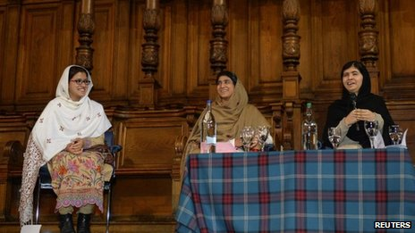 Malala Yousafzai (right) reunited with her friends Kainat Riaz and Shazia Ramzan
