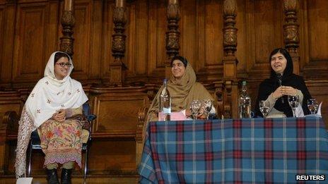Malala Yousafzai (right) reunited with her friends Kainat Riaz and Shazia Ramzan