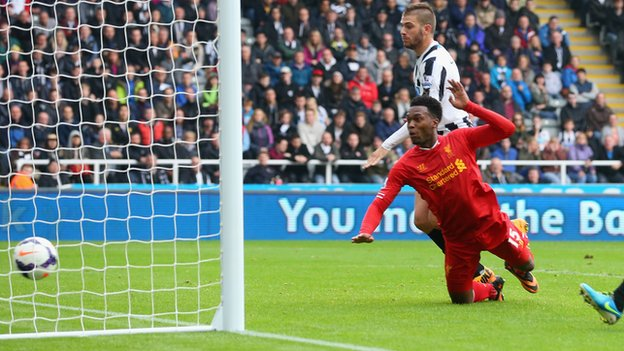 Liverpool striker Daniel Sturridge heads in a goal against Newcastle