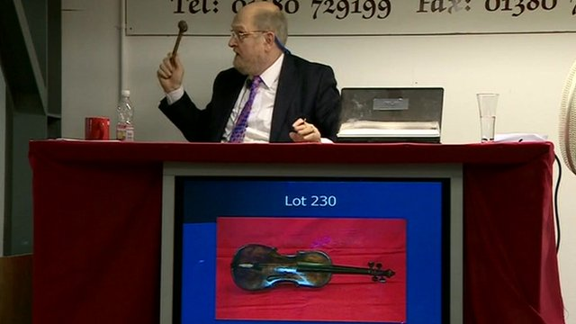 Auctioneer taking final bid on the Titanic violin