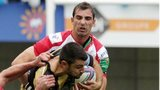 Ruan Pienaar tackles Jonathan Pelissie in the Heineken Cup clash