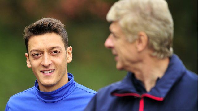 Mesut Ozil and Arsene Wenger