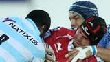George Earle of Scarlets is tackled by Sakiusa Matadigo of Racing Metro 92 and Luc Ducalcon