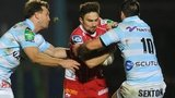 Scarlets' Jordan Williams is tackled by Jonathan Sexton