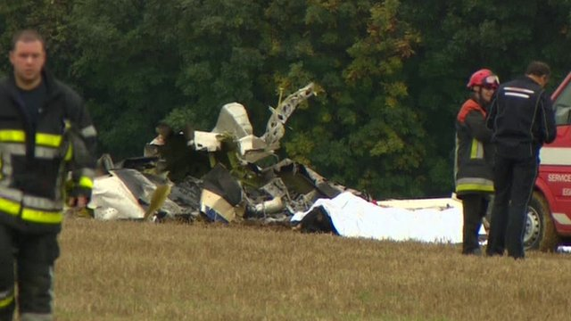 Emergency workers by wreckage of the light plane