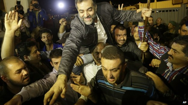 One of the nine released Lebanese Shia pilgrims is carried by relatives in Beirut