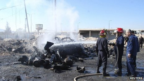 Firefighters at scene of bombing in Hama, 20/10/13