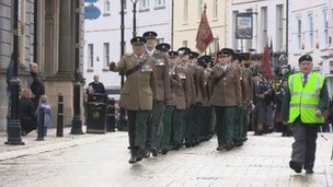 The regimental banner is paraded through Enniskillen