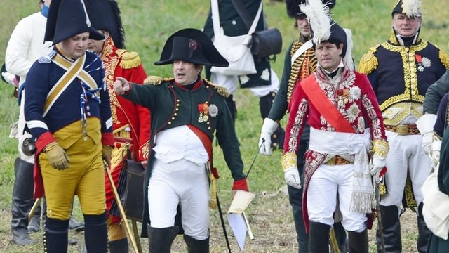 """Actor playing """"Napoleon"""" directs his troops"""