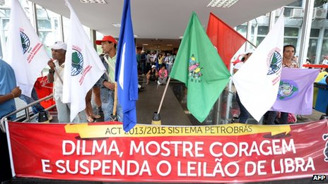 "A banner reading ""Dilma, show courage and suspend the  auction"" is displayed during the occupation of the Ministry of Mines and Energy by activists on 17 October, 2013"