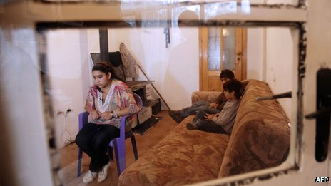 Leonarda Dibrani sits at her home in the town of Mitrovica on 16 October 2013