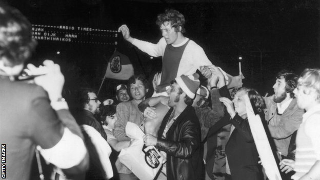Ajax defender Arie Haan is held aloft by fans after the 1971 European Cup final