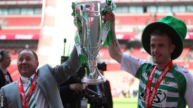 Yeovil's Gary Johnson and Paddy Madden lift the League One play-off trophy