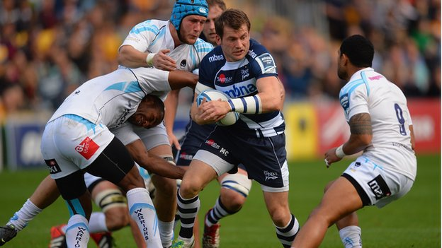 Sale wing Mark Cueto causes chaos at Sixways as he skips inside Josh Drauniniu and Richard De Carpentier