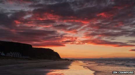 Autumnal sunset over Downhill beach, by Jim Crawford