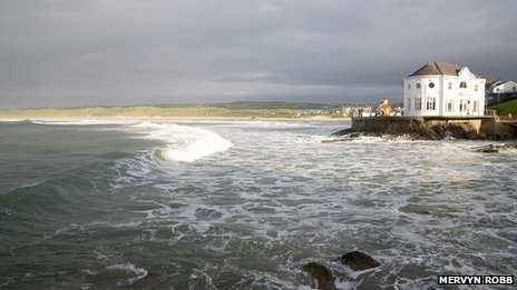 Waves crash against the East Bay in Portrush - by Mervyn Robb