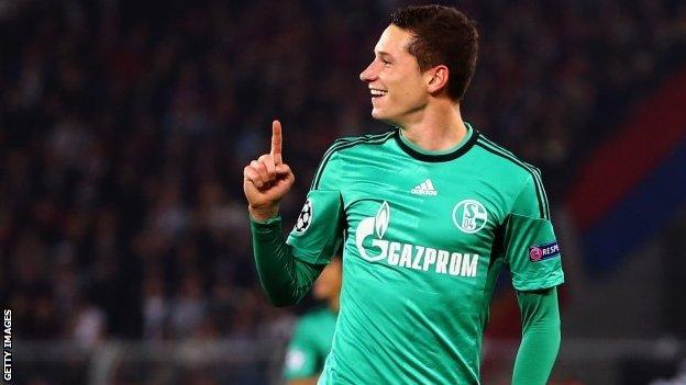 Julian Draxler of Schalke celebrates his team's first goal during the Uefa Champions League Group E match between FC Basel and Schalke 04