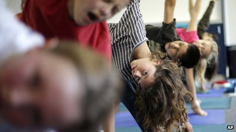 Pupils taking part in yoga class