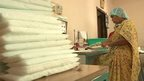 Woman making low-cost sanitary towels