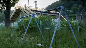 Children's swings lie abandoned in Yubari, Hokkaido