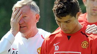 Sir Alex Ferguson puts an arm around Ronaldo in training
