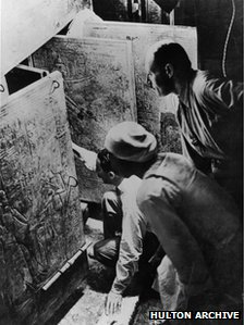 Carter and his assistant opening the tomb