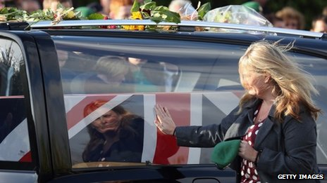 Sharon Brynin, the mother of L/Cpl James Brynin, pays tribute as his coffin passes through Carterton