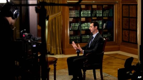 President Bashar Assad gestures as he speaks during an interview with Lebanon's Al-Mayadeen TV