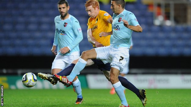 Dave Kitson and Liam Sercombe battle for possession
