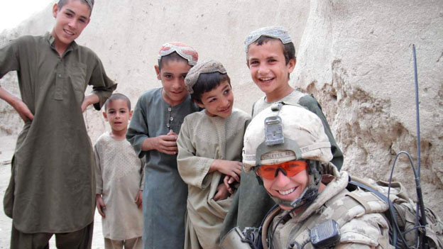 Capt Ashley Collette with local children in Afghanistan